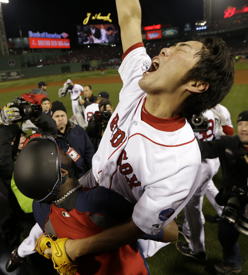 Boston Red Sox's David Ortiz carries relief pitcher Koji Uehara after winning Game 6 of baseball's World Series against the St. Louis CardinalsWednesday, Oct. 30, 2013, in Boston. The Red Sox won 6-1 to win the series. (AP Photo/David J. Phillip)
