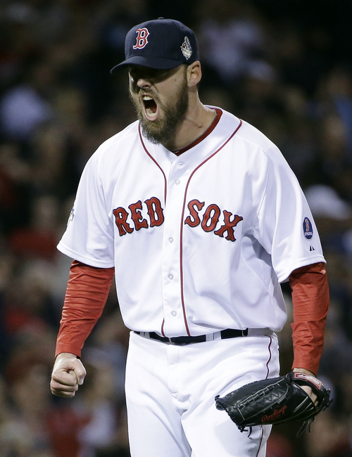 Boston Red Sox starting pitcher John Lackey reacts after getting St. Louis Cardinals' Jon Jay to strike out and end the top of the second inning of Game 6 of baseball's World Series Wednesday, Oct. 30, 2013, in Boston. (AP Photo/David J. Phillip)