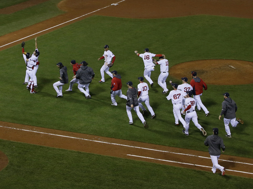Boston Red Sox relief pitcher Koji Uehara jumps into David Ross's arms after defeating the St. Louis Cardinals in Game 6 of baseball's World Series Wednesday, Oct. 30, 2013, in Boston. The Red Sox won 6-1 to win the series.(AP Photo/David J. Phillip)