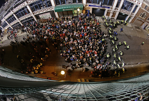 Fans gather in the street outside of Fenway Park during Game 6 of baseball's World Series between the Boston Red Sox and the St. Louis Cardinals Wednesday, Oct. 30, 2013, in Boston. (AP Photo/Charlie Riedel)