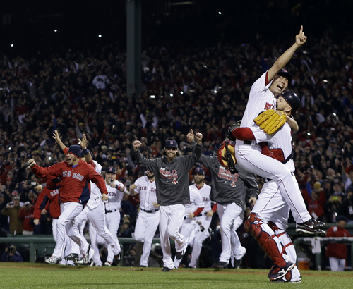 Boston Red Sox relief pitcher Koji Uehara and catcher David Ross celebrate after getting St. Louis Cardinals' Matt Carpenter to strike out and end Game 6 of baseball's World Series Wednesday, Oct. 30, 2013, in Boston. The Red Sox won 6-1 to win the series. (AP Photo/Matt Slocum)