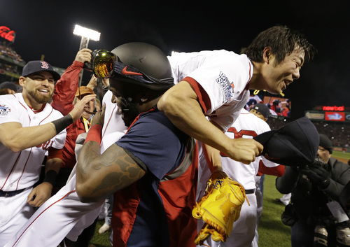 Boston Red Sox's David Ortiz lifts relief pitcher Koji Uehara after Boston defeated the St. Louis Cardinals in Game 6 of baseball's World Series Wednesday, Oct. 30, 2013, in Boston. The Red Sox won 6-1 to win the series. (AP Photo/David J. Phillip)