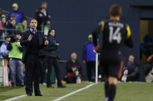 Los Angeles Galaxy head coach Bruce Arena, left, calls to his team in the first half of an MLS soccer match against the Seattle Sounders, Sunday, Oct. 27, 2013, in Seattle. The Sounders and the Galaxy tied 1-1. (AP Photo/Ted S. Warren)