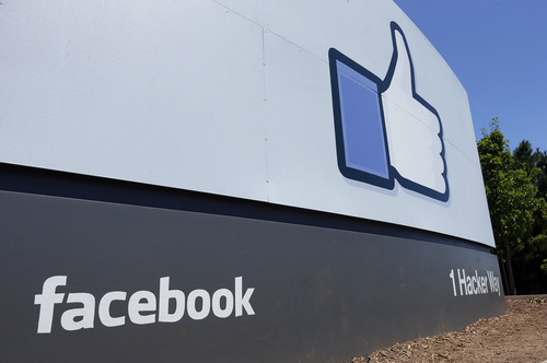FILE - This Tuesday, July 16, 2013, file photo, shows a sign at Facebook's headquarters in Menlo Park, Calif. Facebook reports quarterly earnings on Wednesday, Oct. 30, 2013. (AP Photo/Ben Margot, File)