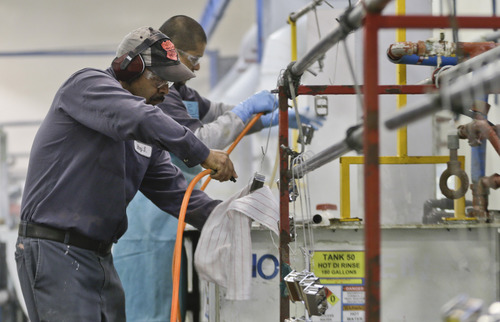 FILE - In this Thursday, Oct. 10, 2013, file photo, employees at Sheffield Platers Inc. work on the factory floor in San Diego. The Institute for Supply Management issues its U.S. manufacturing index for October on Friday,  Nov. 1, 2013. (AP Photo/Lenny Ignelzi, File)