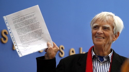Opposition Greens lawmaker Hans-Christian Stroebele,  shows  a letter  to the media,  he claims  he received from  Edward Snowden,  prior to a press conference in Berlin, Germany, Friday, Nov. 1, 2013. Stroebele said he met Edward Snowden in Moscow on Thursday, and that the National Security Agency leaker is prepared to help Germany investigate allegations of surveillance by U.S. intelligence.  Snowden was granted asylum in Russia in August after being stuck at a Moscow airport for more than a month following his arrival there from Hong Kong. The 30-year-old faces espionage charges in the U.S.  (AP Photo/Michael Sohn)