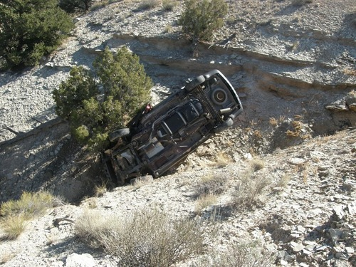 This Oct. 18, 2013, photo released by the Utah Highway Patrol shows a vehicle in a ravine where David Welch was found on Oct. 18, 2013 in eastern Utah. Welch, 54, went missing from Manhattan, Kan., on Sept. 2, 2013. Welch spent his final days trapped in the wreckage of his van in a rural Utah ravine writing goodbye letters to the family he unexpectedly left in early September. (AP Photo/Utah Highway Patrol)