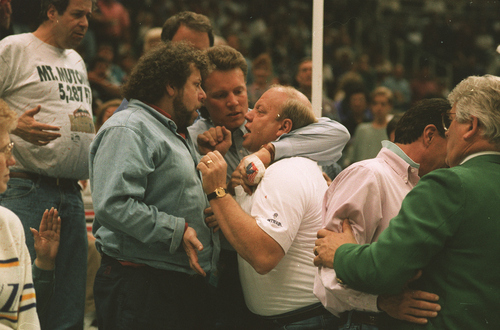 Tribune file photo  Jazz owner Larry H. Miller gets into an argument with a Nuggets fan during a game in 1994.