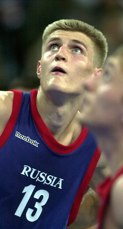 Tribune file photo  Andrei Kirilenko of Russia eyes a rebound during a game against Yugoslavia at Olympic Park in Sydney Sept. 17, 2000. At the time Kirilenkohad been drafted by the Jazz.