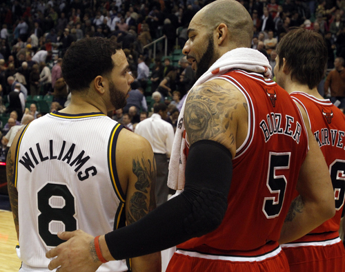 Tribune file photo  Deron Williams gives Carlos Boozer a hug after the Jazz were defeated by the Bulls, in Salt Lake City, Wednesday, February 9, 2011. It was the first game back in Salt Lake City for Boozer and Kyle Korver after they left to join the Bulls. The game was also Jerry Sloan's last game as head coach.