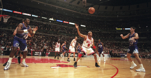 Tribune file photo  John Stockton passes the ball to Karl Malone during game three of the 1998 NBA Finals.