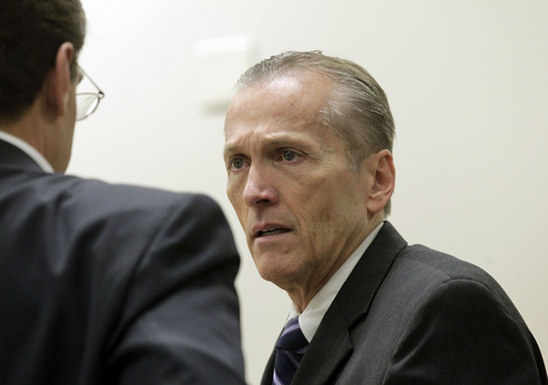 Al Hartmann  |  The Salt Lake Tribune Pleasant Grove physician Martin MacNeill, charged with murder for allegedly killing his wife, Michele MacNeill, in 2007 speaks with his defense lawyer Randy Spencer in Judge Derek Pullan's 4th District Court in Provo, Utah, Friday Nov. 1, 2013.