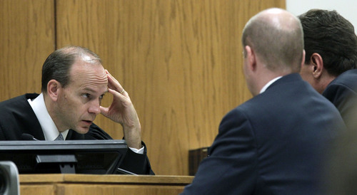 Al Hartmann  |  The Salt Lake Tribune Judge Derek Pullan holds a bench conference with prosecuter Chad Grunander and defense lawyer Randy Spencer over allowable testimony in the Martin MacNeill murder trial in 4th District Court in Provo, Utah, Friday Nov. 1, 2013.