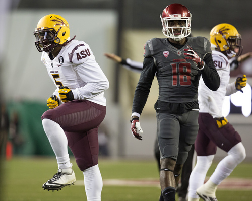 Arizona State linebacker Chris Young (5) celebrates after he and safety Alden Darby, right, broke up a pass intended for Washington State wide receiver Kristoff Williams (18) during the first half of an NCAA college football game Thursday, Oct. 31, 2013, at Martin Stadium in Pullman, Wash. (AP Photo/Dean Hare)