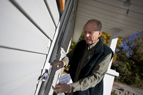 Lennie Mahler  |  The Salt Lake Tribune West Valley City mayoral candidate Ron Bigelow leaves a flier on a door as he canvasses a neighborhood door-to-door Thursday, Oct. 17, 2013.