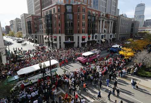 Duck Boats carrying Boston Red Sox players make their way down Boylston Street during a victory parade celebrating the team's third World Series title since 2004, Saturday, Nov. 2, 2013, in Boston. (AP Photo/Michael Dwyer)