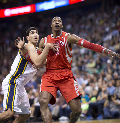 Lennie Mahler  |  The Salt Lake Tribune Jazz center Enes Kanter fights for rebounding position against Rockets center Dwight Howard in the first half of a game against the Houston Rockets on Saturday, Nov. 2, 2013, at EnergySolutions Arena in Salt Lake City.