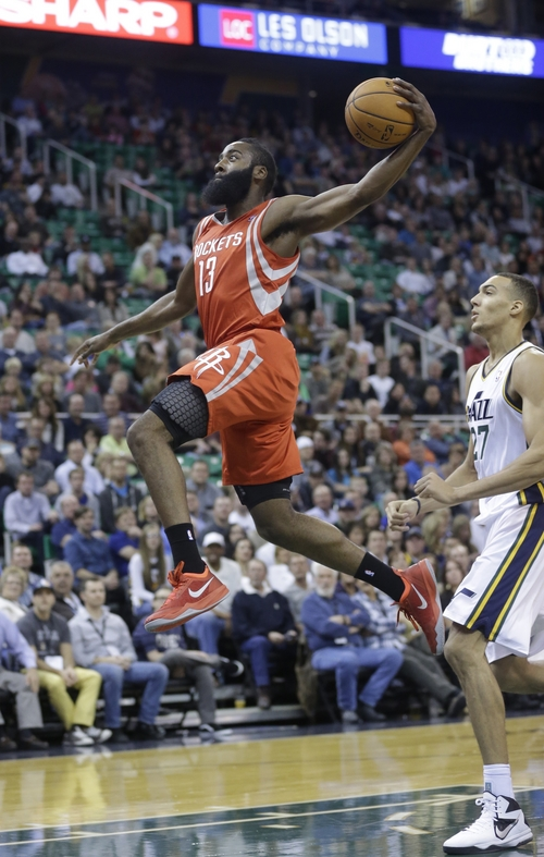 Houston Rockets' James Harden (13) goes to the basket as Utah Jazz's Rudy Gobert (27), of France, looks on in the first half during an NBA basketball game Saturday, Nov. 2, 2013, in Salt Lake City. The Rockets defeated the Jazz 104-93. (AP Photo/Rick Bowmer)