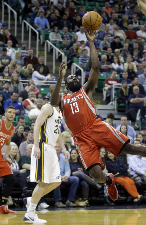 Houston Rockets' James Harden (13) shoots as Utah Jazz's Gordon Hayward (20) looks on in the first quarter during an NBA basketball game Saturday, Nov. 2, 2013, in Salt Lake City.  (AP Photo/Rick Bowmer)