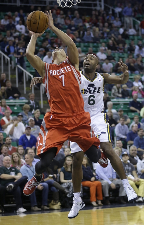 Houston Rockets' Jeremy Lin (7) goes to the basket as Utah Jazz's Jamaal Tinsley (6) defends in the first quarter during an NBA basketball game Saturday, Nov. 2, 2013, in Salt Lake City.  (AP Photo/Rick Bowmer)