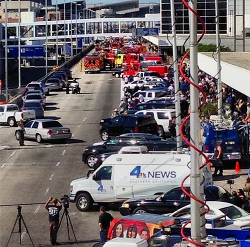Emergency vehicles and satellite news trucks parked outside Terminal 3 at Los Angeles International Airport. (Photo courtesy of sebdollinger on instagram.)