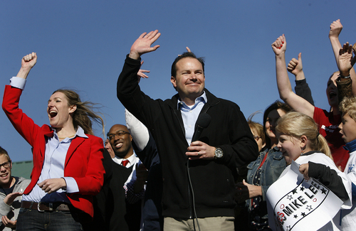 Scott Sommerdorf   |   The Salt Lake Tribune Sen. Mike Lee greets supporters as he arrived at a rally in South Jordan on Saturday, Nov. 2, 2013. At left is rally organizer Amelia Powers.