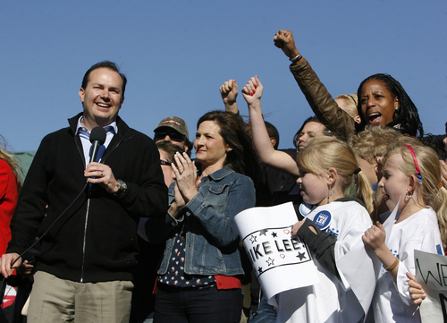 Scott Sommerdorf   |  The Salt Lake Tribune Sen. Mike Lee, with his wife, Sharon, standing next to him, and Saratoga Springs Mayor Mia Love,  far right, showing enthusiastic support, speaks to supporters in  South Jordan on Saturday, Nov. 2, 2013.