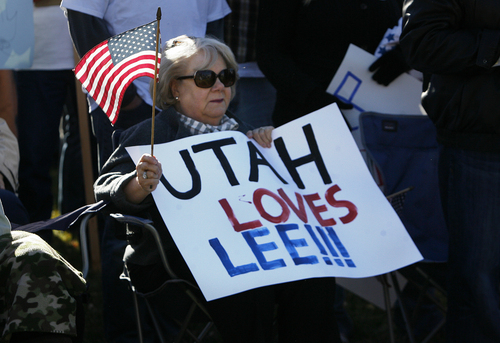 Scott Sommerdorf   |  The Salt Lake Tribune A woman holds a supportive sign as she waits for Sen. Mike Lee to arrive at a rally where he spoke to supporters in South Jordan on Saturday, Nov. 2, 2013.