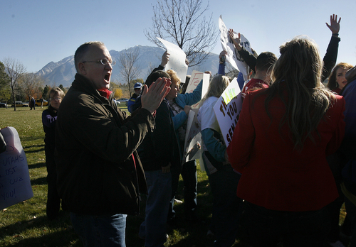 Scott Sommerdorf   |  The Salt Lake Tribune Anti-Mike Lee demonstrators chanted their disapproval of the senator from the fringes of the rally. A rally was held to show support for Sen. Mike Lee in  South Jordan on Saturday, Nov. 2, 2013.