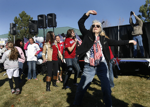 Scott Sommerdorf   |   The Salt Lake Tribune Elizabeth Crofts, 71, dances along with some others as they waited for Sen. Mike Lee to arrive at the rally in South Jordan on Saturday, Nov. 2, 2013.