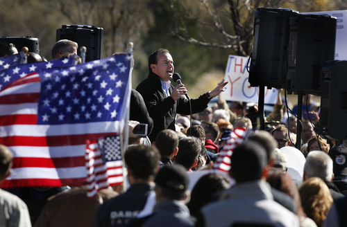 Scott Sommerdorf  |  The Salt Lake Tribune Sen. Mike Lee speaks to enthusiastic supporters on Saturday in South Jordan.