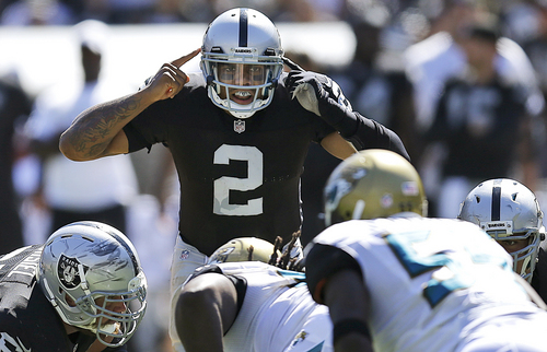 ADVANCE FOR WEEKEND EDITIONS, OCT. 19-20 - FILE - In this Sept. 15, 2013, file photo, Oakland Raiders quarterback Terrelle Pryor (2) signals at the line of scrimmage during the second quarter of an NFL football game against the Jacksonville Jaguars in Oakland, Calif. The Raiders spent the first two years after late owner Al Davis' death looking for a quarterback to build around. Now they finally seem ready to build around the quarterback Davis left them when he used his final draft pick of a near half-century tenure on Pryor.  (AP Photo/Ben Margot, File)