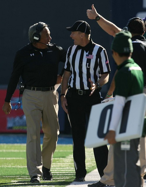 Leah Hogsten  |  The Salt Lake Tribune Hawaii Warriors head coach Norm Chow jaws with the referee over the interception by Utah State. Utah State University hosts Hawaii at Romney Stadium, Saturday, November 2, 2013.