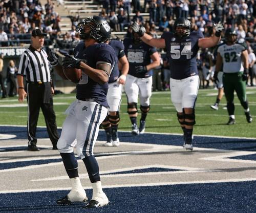 Leah Hogsten  |  The Salt Lake Tribune Utah State Aggies running back Joey DeMartino (28) celebrates his touchdown. Utah State University hosts Hawaii at Romney Stadium, Saturday, November 2, 2013.