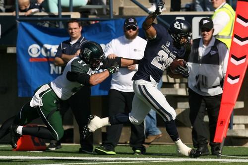 Leah Hogsten  |  The Salt Lake Tribune Utah State Aggies running back Joey DeMartino (28) tries to stay in bounds on a run. Utah State University hosts Hawaii at Romney Stadium, Saturday, November 2, 2013.