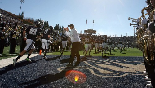 Leah Hogsten  |  The Salt Lake Tribune Utah State Aggies head coach Matt Wells fires up his team as Utah State University hosts Hawaii at Romney Stadium, Saturday, November 2, 2013.