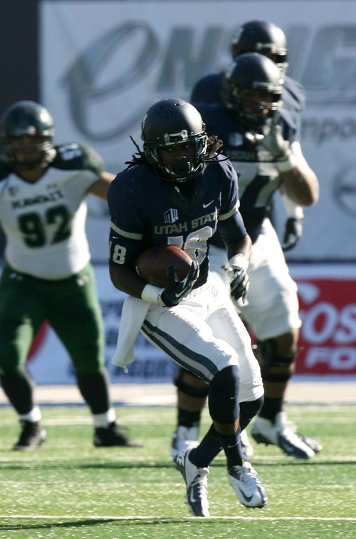 Leah Hogsten  |  The Salt Lake Tribune Utah State Aggies wide receiver Ronald Butler (18). Utah State University hosts Hawaii at Romney Stadium, Saturday, November 2, 2013.