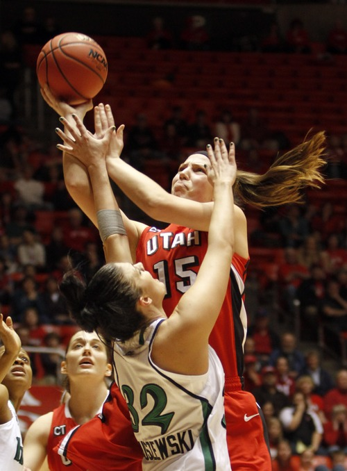 Rick Egan   |  The Salt Lake Tribune  Utah's Michelle Plouffe takes a shot, as  Notre Dame Forward, Becca Bruswzewski (32) defends for the Irish, in NCAA tournament game, at the Jon M. Huntsman Center in Salt Lake City, Saturday, March 19, 2011
