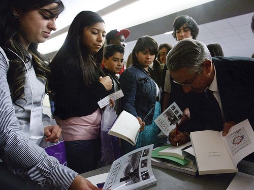 """Leah Hogsten     The Salt Lake Tribune Third District Court juvenile Judge Andrew Valdez autographs his book """"No One Makes It Alone,"""" for Utah high school students. Valdez talked about his  mentor and his humble roots as a Latino kid growing up on the west side to becoming a respected juvenile judge, Wednesday, October 30, 2013, at the annual Multicultural Youth Leadership Summit at Weber State University. Judge Andrew Valdez retired Friday, November 1, 2013 after 20 years on the bench."""