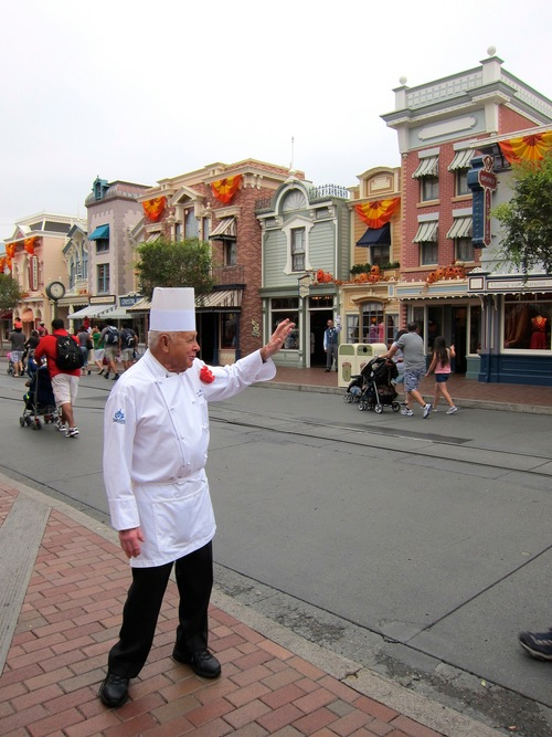In this photo taken Sept. 20, 2013, Oscar Martinez, 77, greets diners at the Carnation Cafe at Disneyland in Anaheim, Calif. The chef is the park's longest-tenured employee, beginning as a busboy nearly 57 years ago. He says he loves his job, and a new poll from the Associated Press-NORC Center for Public Affairs finds he's not alone: Nine out of ten workers 50 and older say they're satisfied with their work. (AP Photo/Matt Sedensky)