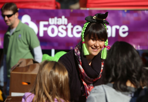 Francisco Kjolseth  |  The Salt Lake Tribune Brandi Sweet, the newly appointed American Indian foster family recruiter for Utah Foster Care, attends the organization's 12th Annual Pumpkin Festival at the Gateway Mall on Friday, Oct. 18, 2013.