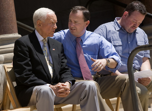 Al Hartmann  |  The Salt Lake Tribune Utah Senators Orrin Hatch, left and Mike Lee talk before a rally for a balanced budget amendment at the Salt Lake City-County Building Friday July 8.  State Representative Karl Wimmer at right.