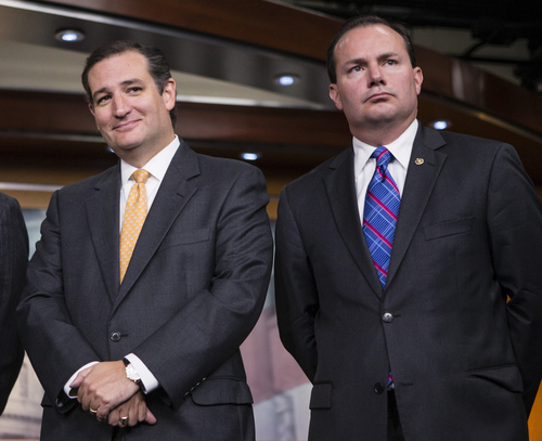 Sen. Ted Cruz, R-Texas, left, and Sen. Mike Lee, R-Utah, during a news conference with conservative Congressional Republicans at the Capitol in Washington, Thursday, Sept. 19, 2013.  Cruz and Lee stand as the Senate?s dynamic duo for conservatives, crusading against President Barack Obama?s health care law while infuriating many congressional Republicans with a tactic they consider futile, self-serving and detrimental to the party?s political hopes in 2014. (AP Photo/J. Scott Applewhite)
