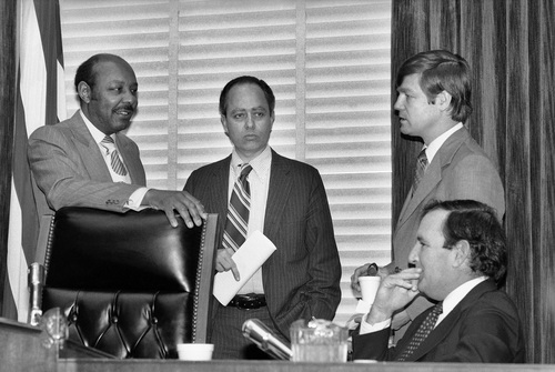 """FILE - In this Friday, Dec. 22, 1978 file photo, House Assassinations Committee chief counsel G. Robert Blakey, second left, meets with committee chairman Louis Stokes, D-Ohio, left, before the panel went into closed session in Washington to explore new evidence of a second gunman in the assassination of President John F. Kennedy. Others are unidentified. Blakey recalled how the CIA brought in Agent George Joannides to act as a middleman to help fill requests for documents made by committee researchers. """"He was put in a position to edit everything we were given before it was given to us,"""" Blakey said. (AP Photo/Dennis Cook)"""