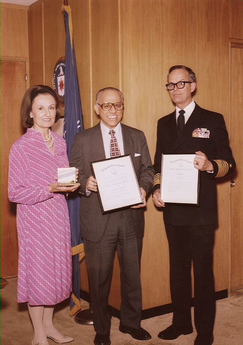 In this Wednesday, July 15, 1981 photo made by the Central Intelligence Agency and obtained by Jefferson Morley, a former Washington Post reporter and author, George Joannides holds an award for his over 28 years of service at the agency, presented by U.S. Navy Adm. B.R. Inman, director of the CIA, right, at the agency's headquarters in Langley, Va. At left is Joannides' wife, Violet. Five decades after President John F. Kennedy's assassination, Joannides files and thousands more pages primarily from the CIA remain off-limits at a National Archives center in College Park, Md. (AP Photo/CIA via Jefferson Morley)