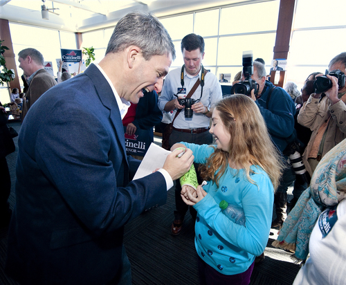 Courtney Begoon, 9, from Crimora, has her arm cast autographed by Republican gubernatorial candidate Ken Cuccinelli after the campaign rally at the Shenandaoh Valley Regional Airport in Weyers Cave Sunday, Nov. 3, 2013. (AP Photo/Daily News-Record, Michael Reilly)