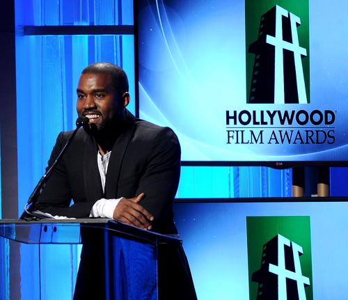 "FILE - In this Tuesday, Oct. 22, 2013 file photo, recording artist Kanye West speaks onstage during the 17th Annual Hollywood Film Awards Gala at the Beverly Hilton Hotel in Beverly Hills, Calif. West is postponing the rest of his ""Yeezus"" tour after a 60-foot LED screen used during his shows was damaged. A representative for the rapper says a truck that carried the screen was in an accident Wednesday, Oct. 30, 2013, that has ""damaged the gear beyond repair.""  (Photo by Frank Micelotta/Invision/AP, File)"