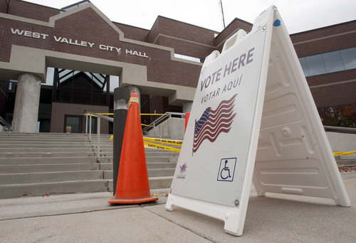 Steve Griffin  |  The Salt Lake Tribune  Early voting is underway at various City Halls and other selected community centers throughout the valley. Here, signs show that the West Valley City Hall is open for voting Monday, October 28, 2013.
