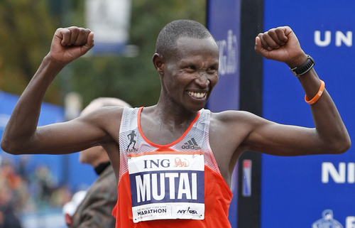 Geoffrey Mutai of Kenya celebrates his first place win in the men's division of the New York City Marathon, Sunday, Nov. 3, 2013, in New York. (AP Photo/Kathy Willens)