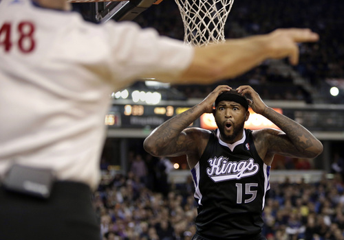 Sacramento Kings center DeMarcus Cousins (15) looks at official Scott Foster (48) after being called for a foul during the fourth quarter of an NBA basketball game against the Los Angeles Clippers in Sacramento, Calif., Friday, Nov. 1, 2013. The Clippers won 110-101. (AP Photo/Rich Pedroncelli)